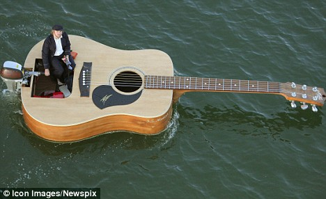 guitar teacher in sydney floating at the Eastern Suburbs beach
